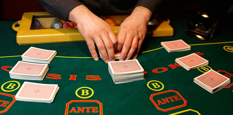 Dealer Shuffling Cards at a Table